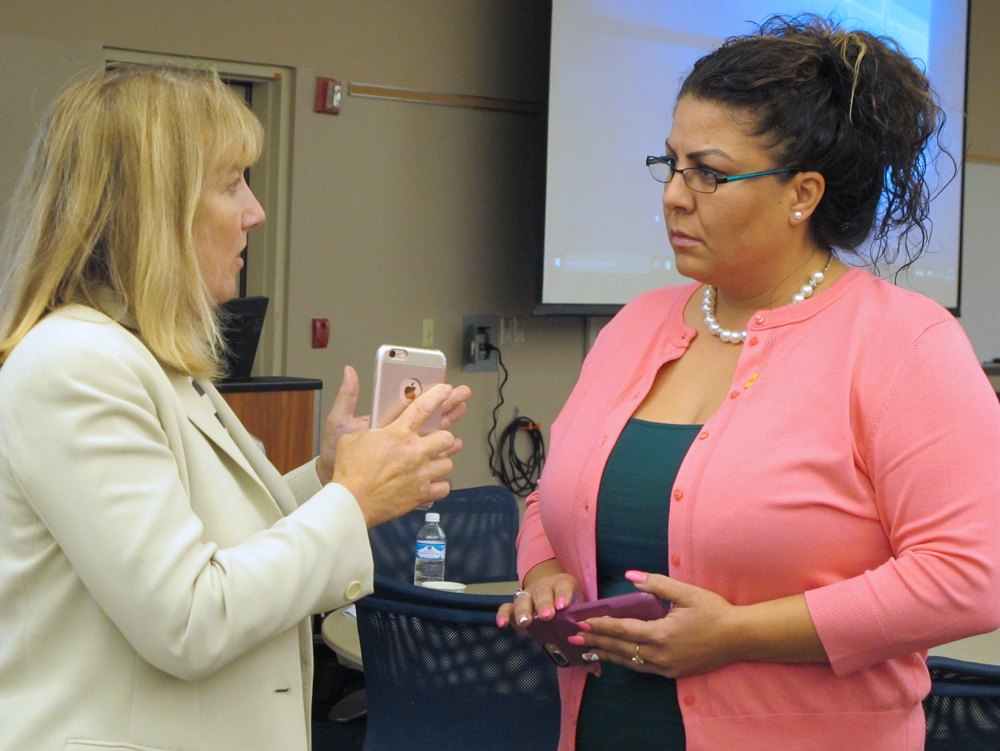 GPA's Deanne Woodring and Sandoval County Treasurer Laura Montoya talked after the meeting.