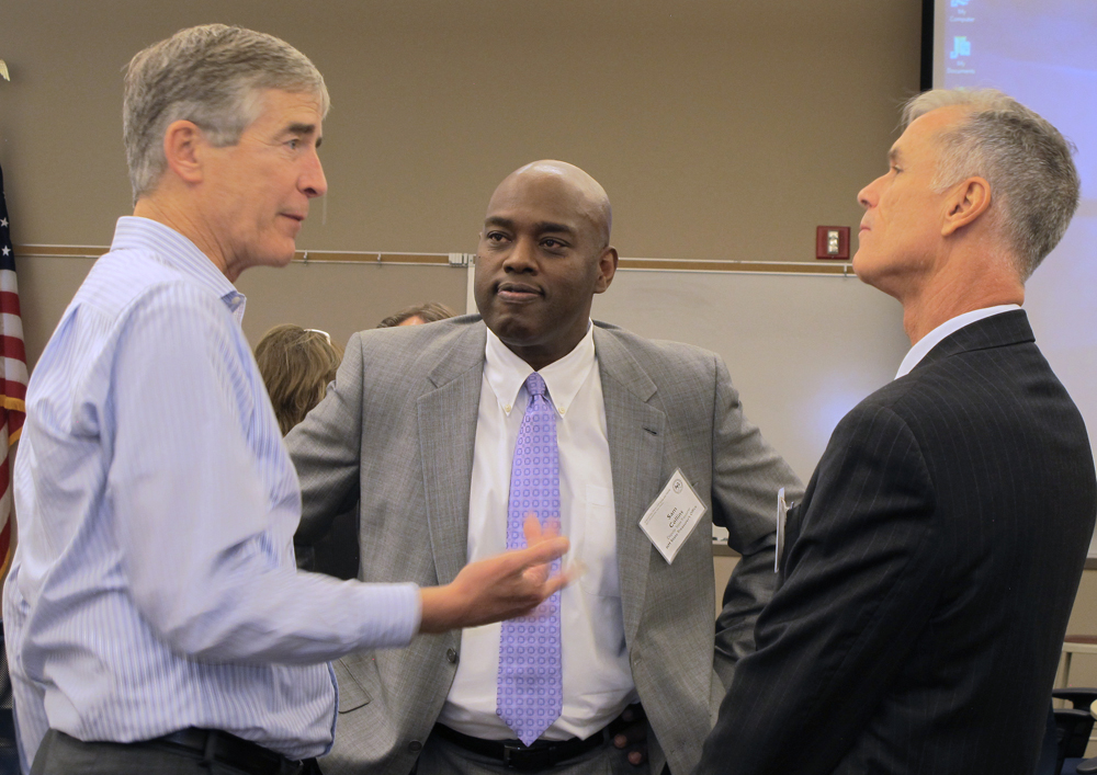 Deputy State Treasurer Sam Collins (center) talked with Mark Jensen of Wells Fargo Bank (left) and Doug Safford of Wells Fargo Securities.